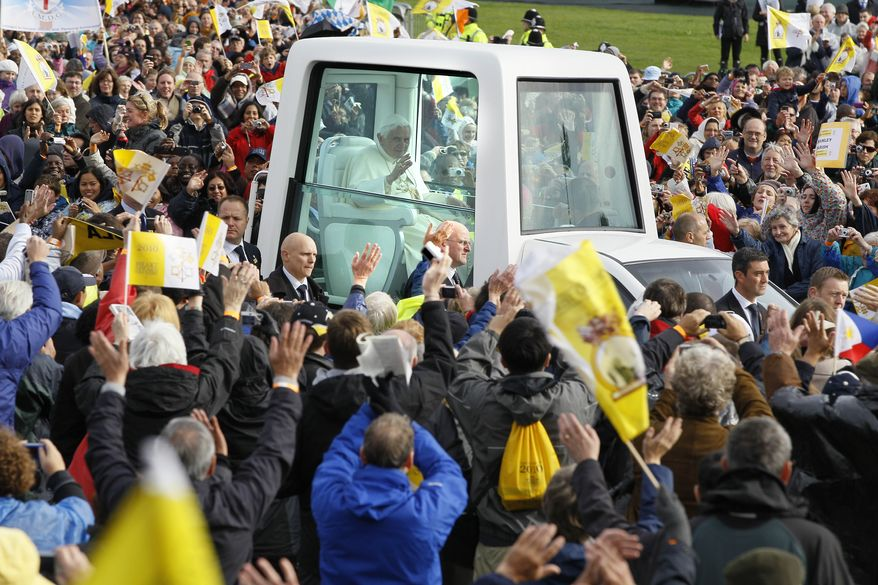 Pope Benedict XVI arrives at Cofton Park in Birmingham, England, on Sunday, Sept. 19, 2010, to celebrate an open-air Mass. (AP Photo/Kirsty Wigglesworth)
