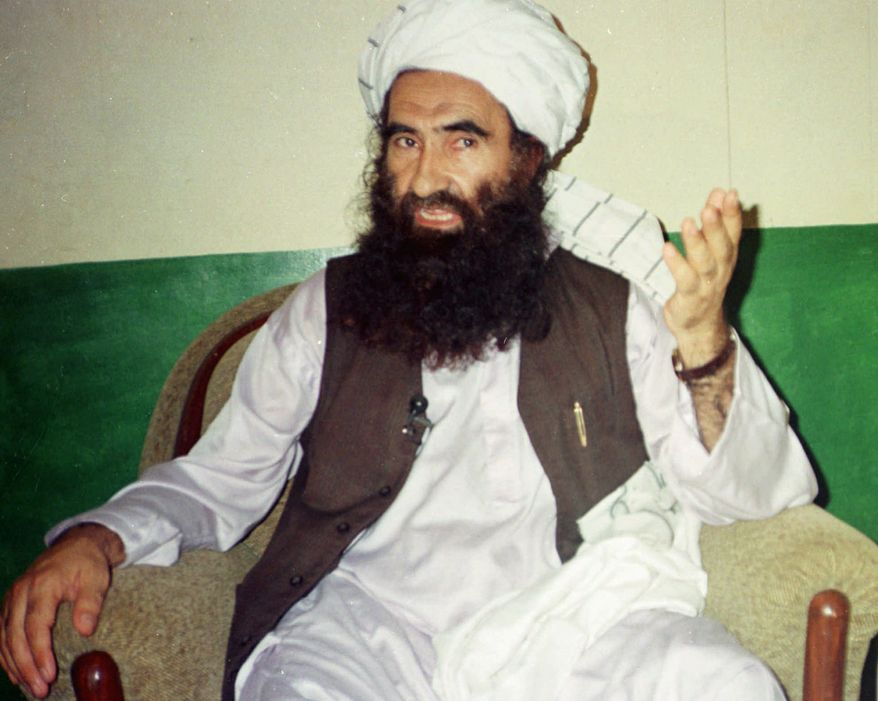 ** FILE ** Jalaluddin Haqqani, then the supreme commander of the Taliban army, talks with reporters in Miram Shah in Pakistan's Waziristan region in 1998. (AP Photo/Mohammad Riaz, File)
