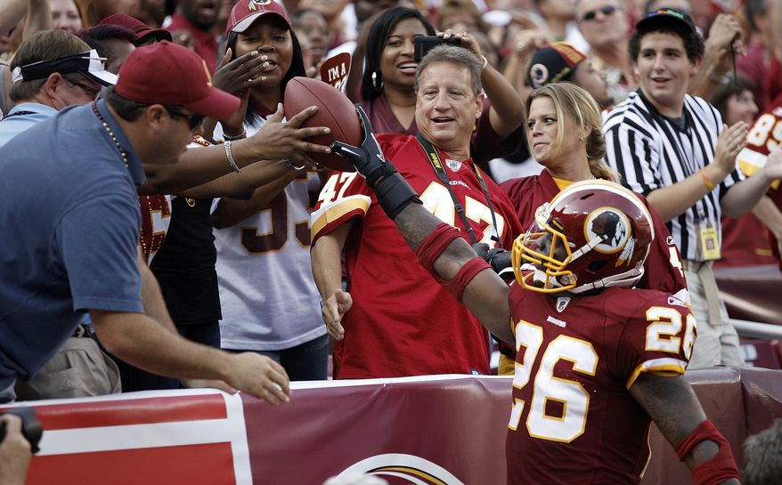 Washington Redskins  running back Clinton Portis gives the ball to the fans after scoring during the first half of an NFL football game against the Houston Texans in Landover, Md., on Sunday, Sept. 19, 2010. (Associated Press)