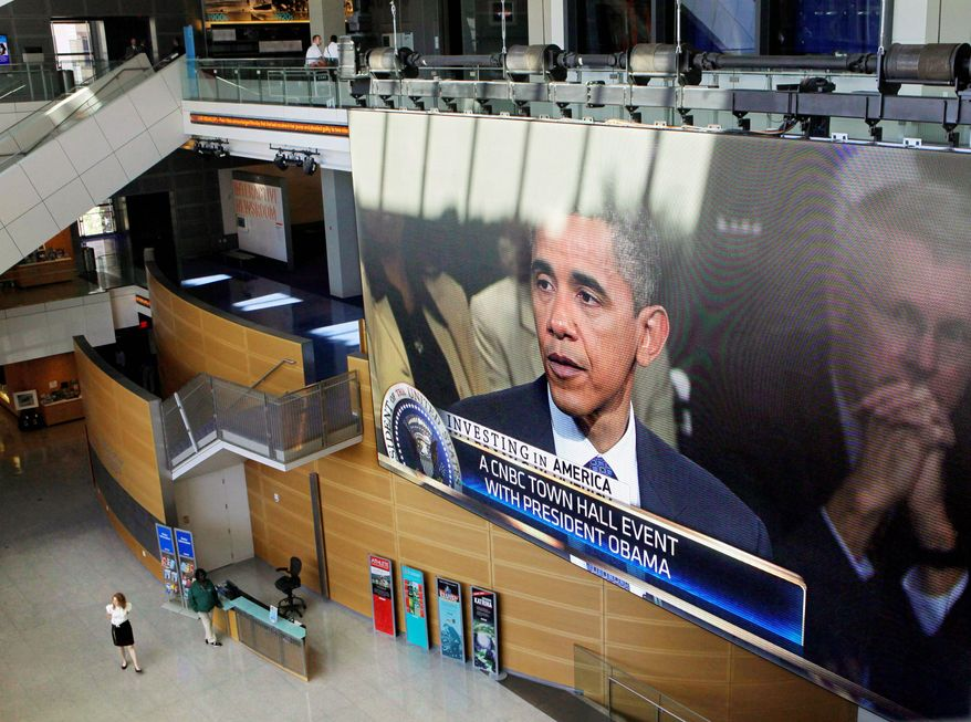 SPOTLIGHTED: President Obama is displayed on a large video screen Monday at the Newseum in Washington, where he discussed jobs and the economy during a town-hall gathering hosted by CNBC. (Associated Presss)