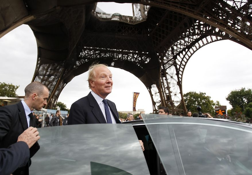 French Interior Minister Brice Hortefeux leaves after meeting with security forces at the Eiffel Tower in Paris on Thursday, Sept. 16, 2010. (AP Photo/Francois Mori)