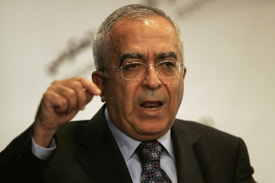 ** FILE ** Palestinian Prime Minister Salam Fayyad speaks to the media in the West Bank city of Ramallah on Monday, Aug. 30, 2010. (AP Photo/Majdi Mohammed)