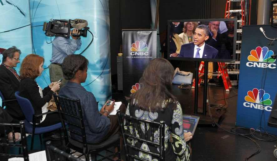 President Obama discusses jobs and the economy during a town hall-style gathering hosted by CNBC, Monday, Sept. 20, 2010, at the Newseum in Washington. The White House press pool, reporters who accompany the president, were not allowed in the event and watched Mr. Obama on a video screen from a holding room. (AP Photo/J. Scott Applewhite)