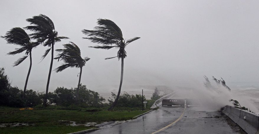 High winds push water over the closed causeway leading to Bermuda's L.F. Wade International Airport as Hurricane Igor moves ashore on Sunday, Sept. 19, 2010. (AP Photo/Gerry Broome)