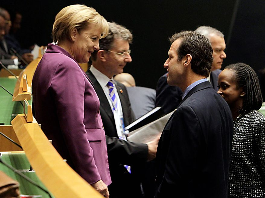 Chancellor Angela Merkel, left, of Germany talks to a fellow delegate at the summit on the Millennium Development Goals at United Nations headquarters,  Monday, Sept. 20, 2010. (AP Photo/Richard Drew)