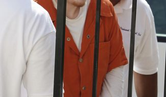 "** FILE ** Aspiring hard-core rapper Richard ""Sam"" McCroskey is led into the Prince Edward County Courthouse in Farmville, Va., for a hearing on Tuesday, June 22, 2010. (AP Photo/Steve Helber, File)"