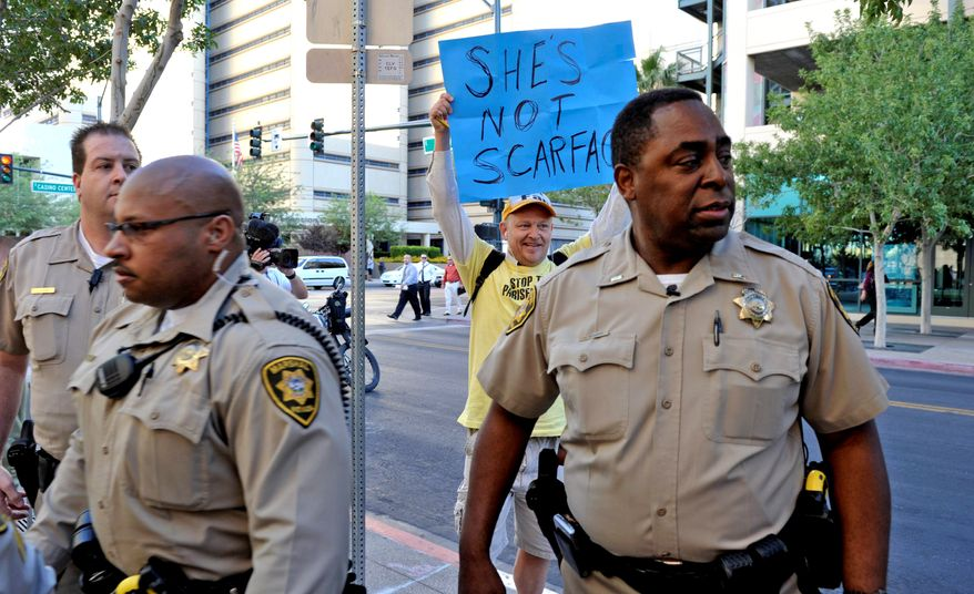 Lone protester Jake Byrd, of Chino, Calif., holds a sign in support for Paris Hilton as she departs the Clark County Regional Justice Center in Las Vegas, Nev. on Monday, Sept. 20, 2010. (AP Photo/Mark Damon)
