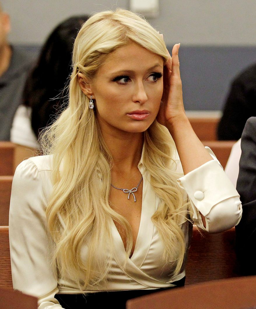 Paris Hilton waits for her hearing to start in Clark county court, Monday, Sept. 20, 2010, in Las Vegas. Hilton pleaded guilty to two misdemeanor charges stemming from her arrest last month at a Las Vegas hotel-casino.  She will serve a year of probation and avoid a felony charge under the terms of a plea deal worked out with prosecutors.  (AP Photo/Julie Jacobson)