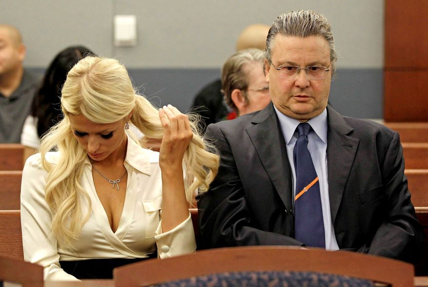 Paris Hilton, left, waits for her hearing to start in county court with her attorney David Chesnoff to plead guilty to reduced charges in her August cocaine arrest Monday, Sept. 20, 2010, in Las Vegas. Under the terms of a plea deal worked out with prosecutors, the heiress will serve a year of probation and avoid a felony conviction. (AP Photo/Julie Jacobson)