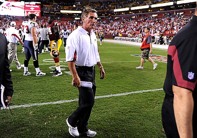 Washington Redskins head coach Mike Shanahan walks off the field after the Redskins were defeated by the Houston Texans 30-27 at FedEx Field in Washington on September 19, 2010.   UPI/Kevin Dietsch