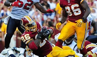 Washington Redskins' running back Clinton Portis rushes for a 1-yard touchdown against the Houston Texans during the second quarter at FedEx Field in Washington on September 19, 2010.   UPI/Kevin Dietsch