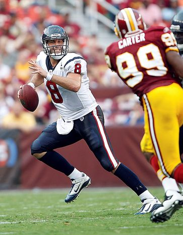 Houston Texans quarterback Matt Schaub scrambles during the second half an NFL football game against the Washington Redskins in Landover, Md., on Sunday, Sept. 19, 2010.  The Houston Texans won 30-27 in overtime. (AP Photo/Evan Vucci)