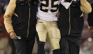 New Orleans Saints running back Reggie Bush (25) is carted off the field after being injured during the fourth quarter against the San Francisco 49ers in an NFL football game in San Francisco, Monday, Sept. 20, 2010. (AP Photo/Marcio Jose Sanchez)