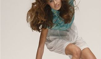 A model falls as she wears an outfit by designer Betty Jackson during her show at London Fashion Week ,Saturday, Sept. 18, 2010. (AP Photo/Alastair Grant)