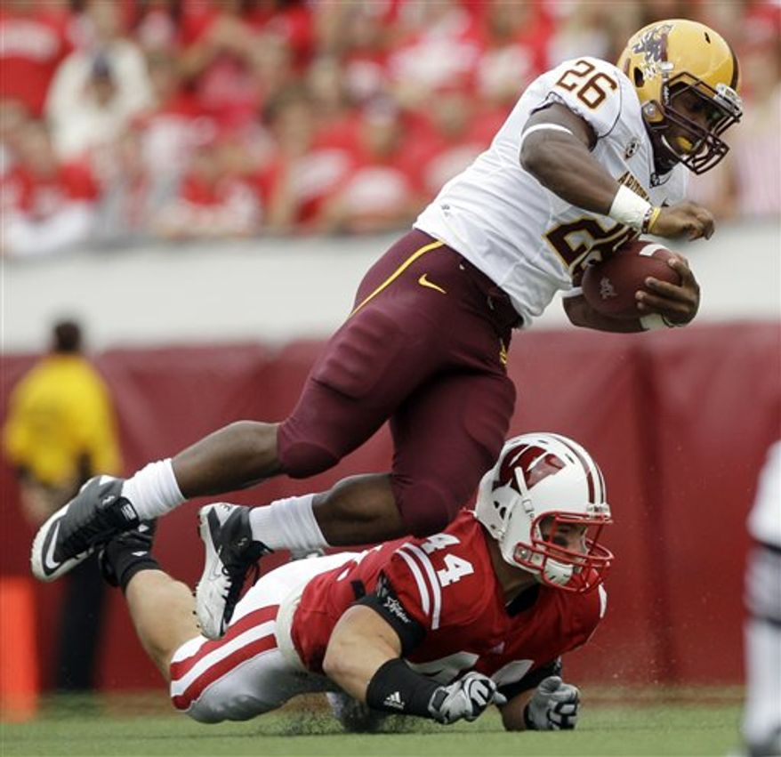 Wisconsin corner back Antonio Fenelus (26) breaks up a pass intended for Arizona State's George Bell (13) during the first half of an NCAA college football game Saturday, Sept. 18, 2010, in Madison, Wis. (AP Photo/Morry Gash)