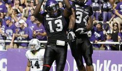 TCU punter Anson Kelton (47) and long snapper Daniel Shelley (50) warm up before the start of an NCAA football game against Baylor, Saturday, Sept. 18, 2010 in Fort Worth, Texas. (AP Photo/Tony Gutierrez)