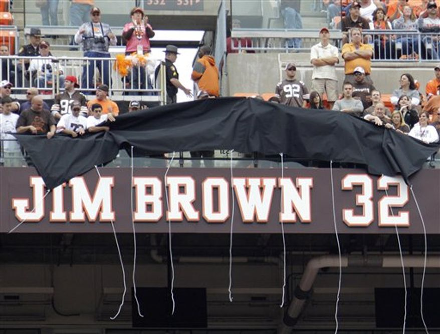 A cover is lifter to reveal the name of Jim Brown as the Cleveland Browns honored 16 Hall of Fame players in their Ring of Honor at halftime of an NFL football game between the Browns and Kansas City Chiefs Sunday, Sept. 19, 2010, in Cleveland. (AP Photo/Mark Duncan)
