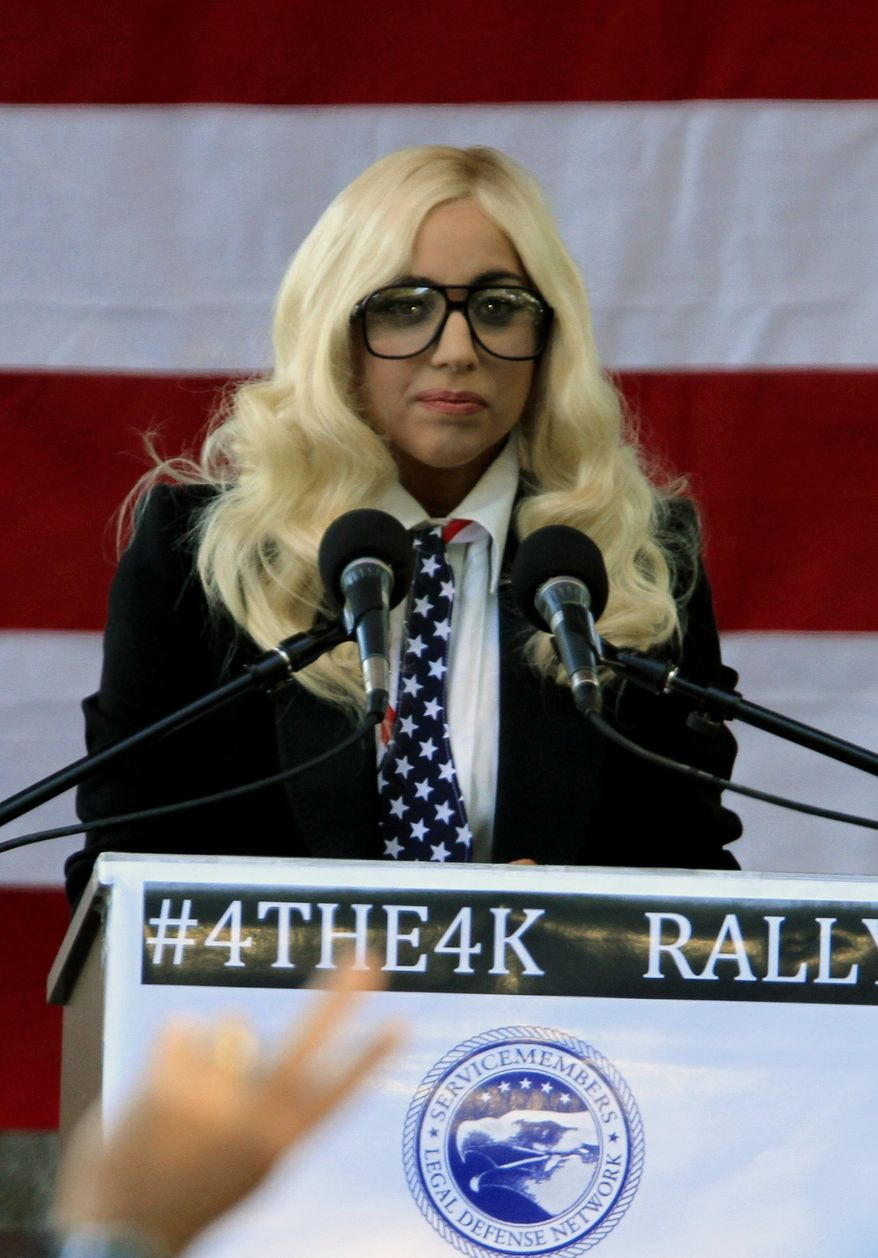"""Recording artist Lady Gaga speaks at a rally in support of repealing the military's """"don't ask, don't tell"""" policy for gay service members, in Portland, Maine, on Monday, Sept. 20, 2010. (AP Photo/Pat Wellenbach)"""
