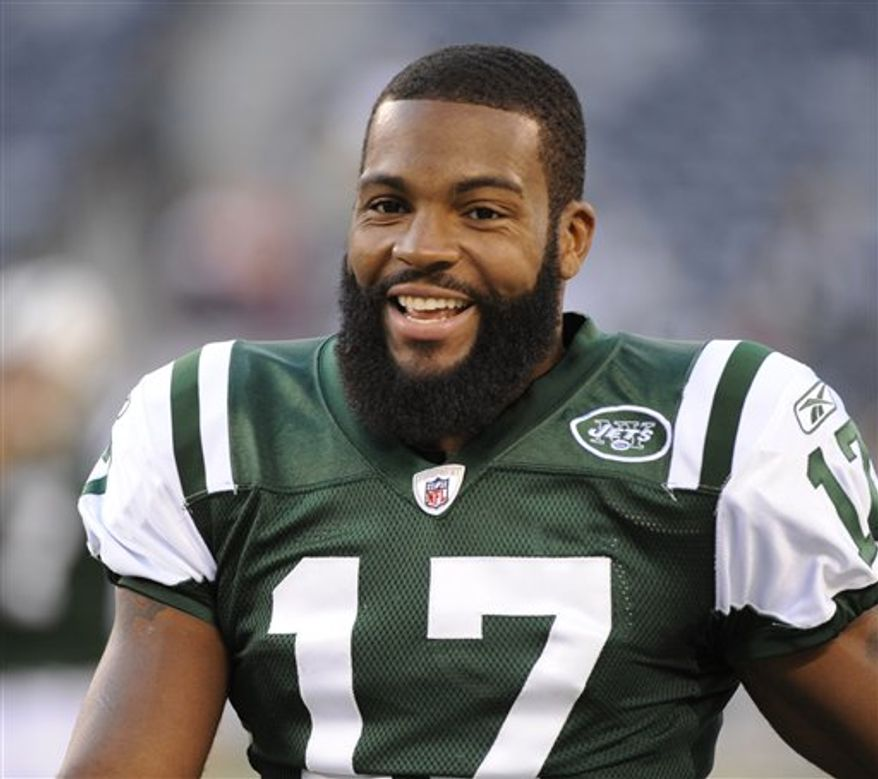 FILE - This Sept. 2, 2010, file photo shows New York Jets wide receiver Braylon Edwards on the sidelines in the second half of an NFL preseason football game against the Philadelphia Eagles, in Philadelphia.  Edwards has been arrested in Manhattan on a charge of driving while intoxicated.  A law enforcement official tells The Associated Press that Edwards was pulled over on the west side of Manhattan around 5:15 a.m. Tuesday, Sept. 21, 2010,  because his vehicle had excessive tinting on its windows. The official says police noticed a strong smell of alcohol and arrested Edwards. (AP Photo/Mel Evans, File)