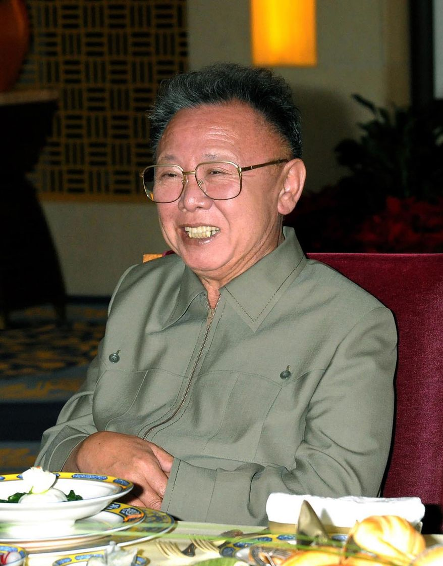 ** FILE ** In this file photo taken during Kim Jong Il's recent visit to China and released by Korean Central News Agency via Korea News Service in Tokyo May 9, 2010, North Korean leader Kim Jong Il smiles during a meeting with Chinese President Hu Jintao in China. North Korea will hold its biggest political meeting in 30 years next week, state media reported Tuesday, Sept. 21, 2010, as observers watched for signs that the secretive regime's aging leader has chosen his son to succeed him. (AP Photo/Korean Central News Agency via Korea News Service)