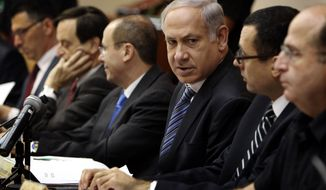 Israeli Prime Minister Benjamin Netanyahu (third from right) chairs the weekly Cabinet meeting in Jerusalem on Sunday, Sept. 19, 2010. (AP Photos/Jim Hollander, Pool)