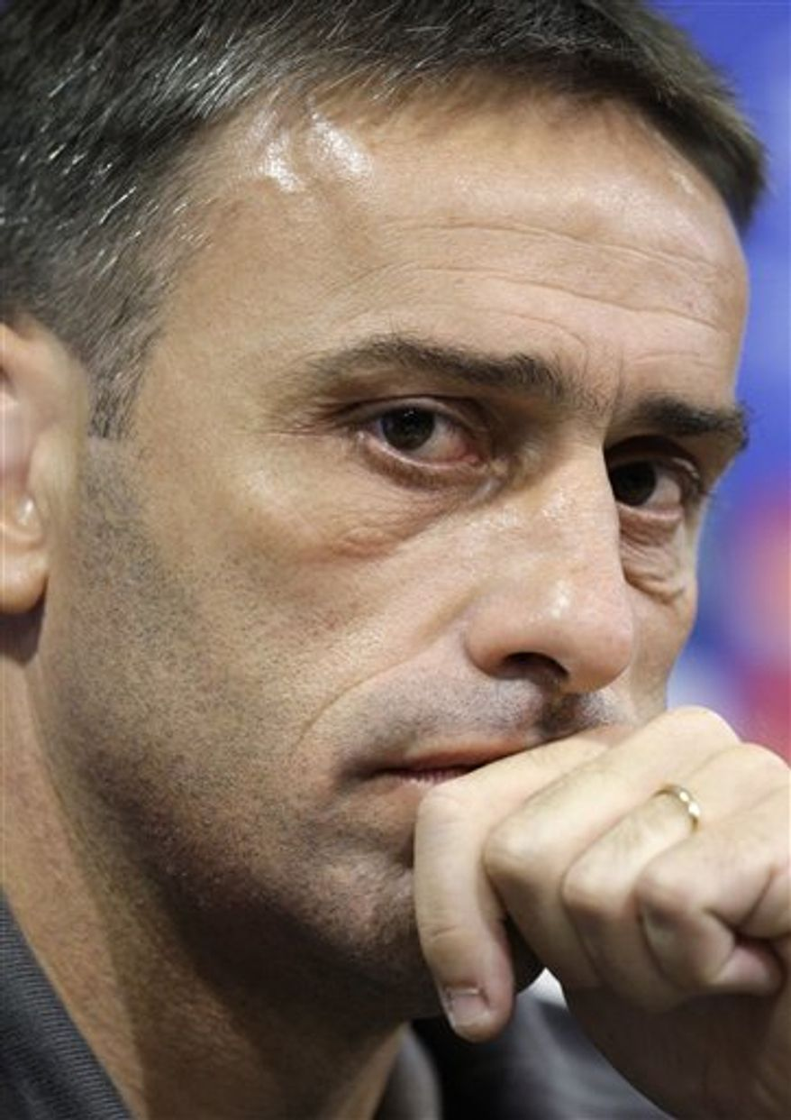 FILE - In this Sept. 30, 2008 file photo, Sporting's head coach Paulo Bento listens to questions during a news conference ahead of a Champions League soccer match at the Alvalade stadium in Lisbon. The Portuguese Soccer Federation announced Tuesday, Sept. 21 2010 that it has appointed Bento coach of Portugal. The 41-year-old Bento replaces Carlos Queiroz, who was fired earlier this month. (AP Photo/Armando Franca)