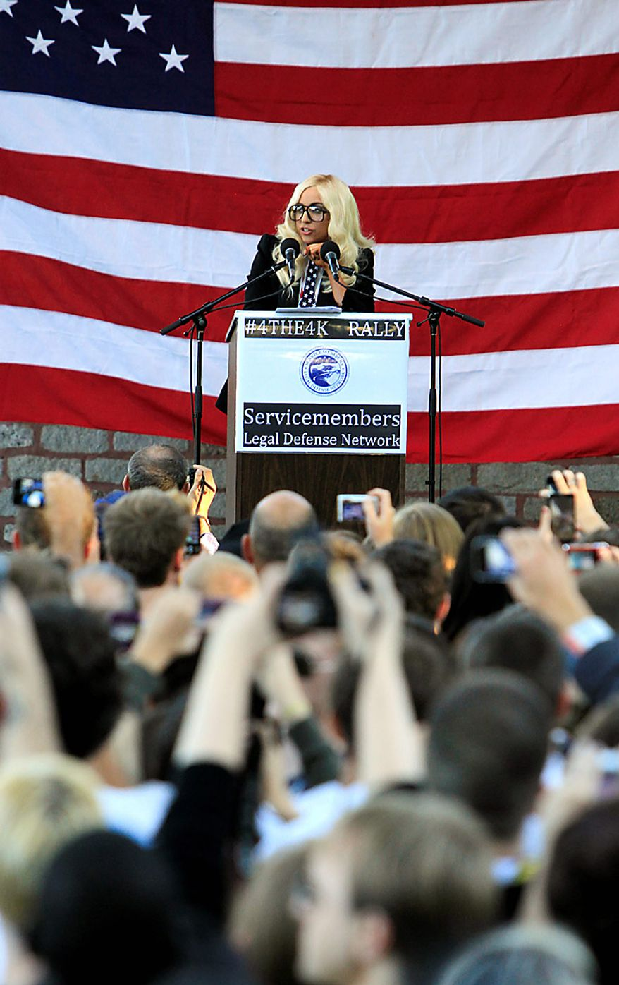 """Members of the crowd react to recording artist Lady Gaga as she speaks at a rally in support of repealing the so-called """"don't ask, don't tell"""" law, in Portland, Maine, on Monday, September 20, 2010. The current law bars gays and lesbians from openly serving in the military, and a spokesperson said that Lady Gaga wants Maine's Republican senators to cast votes this week to help repeal the military's """"don't ask., don't tell"""" policy on gays in the military. (AP Photo/Pat Wellenbach)"""