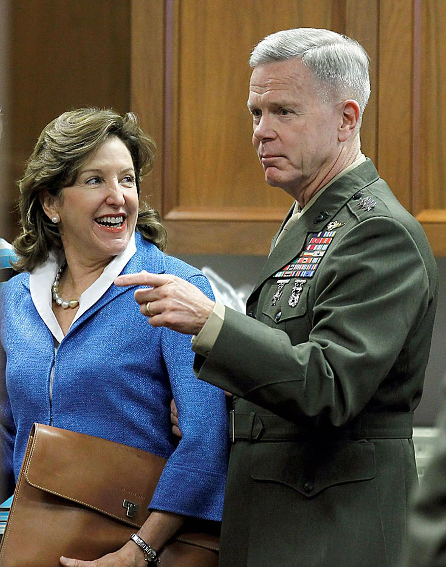 Senate Armed Services Committee member Sen. Kay Hagan, D-N.C., stands next to US Marines Gen. James F. Amos in a waiting room on Capitol Hill in Washington, Tuesday, Sept. 21, 2010, prior to the start of the committee's hearing on Amos' reappointment to the grade of general and the be Commandant of the Marine Corps. (AP Photo/Alex Brandon)