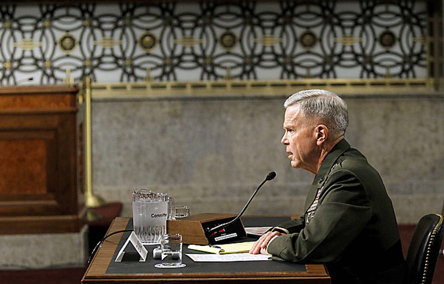 US Marines Gen. James F. Amos testifies on Capitol Hill in Washington, Tuesday, Sept. 21, 2010, before the Senate Armed Services Committee hearing on his nomination for reappointment to the grade of general and the be Commandant of the Marine Corps. (AP Photo/Alex Brandon)
