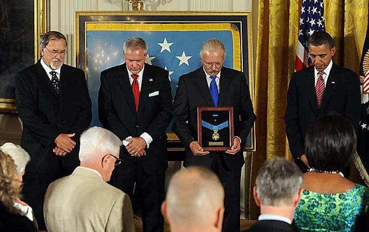 U.S. President Barack Obama stands with sons Steven Wilson and Cory and Richard Etchberger after Obama awarded Chief Master Sergeant Richard L. Etchberger, U.S. Air Force, the Medal of Honor for conspicuous gallantry in the East Room of the White House in Washington on September 21, 2