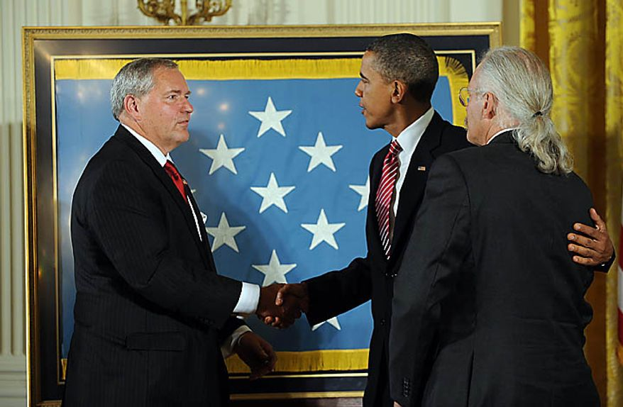 U.S. President Barack Obama joins sons Cory Etchberger (L) and Richard Etchberger during a ceremony to award Chief Master Sergeant Richard L. Etchberger, U.S. Air Force, the Medal of Honor for conspicuous gallantry in the East Room of the White House in Washington on September 21, 2010. Etchberger was killed in Laos in 1968 helping to save wounded men. UPI/Roger L. Wollenberg