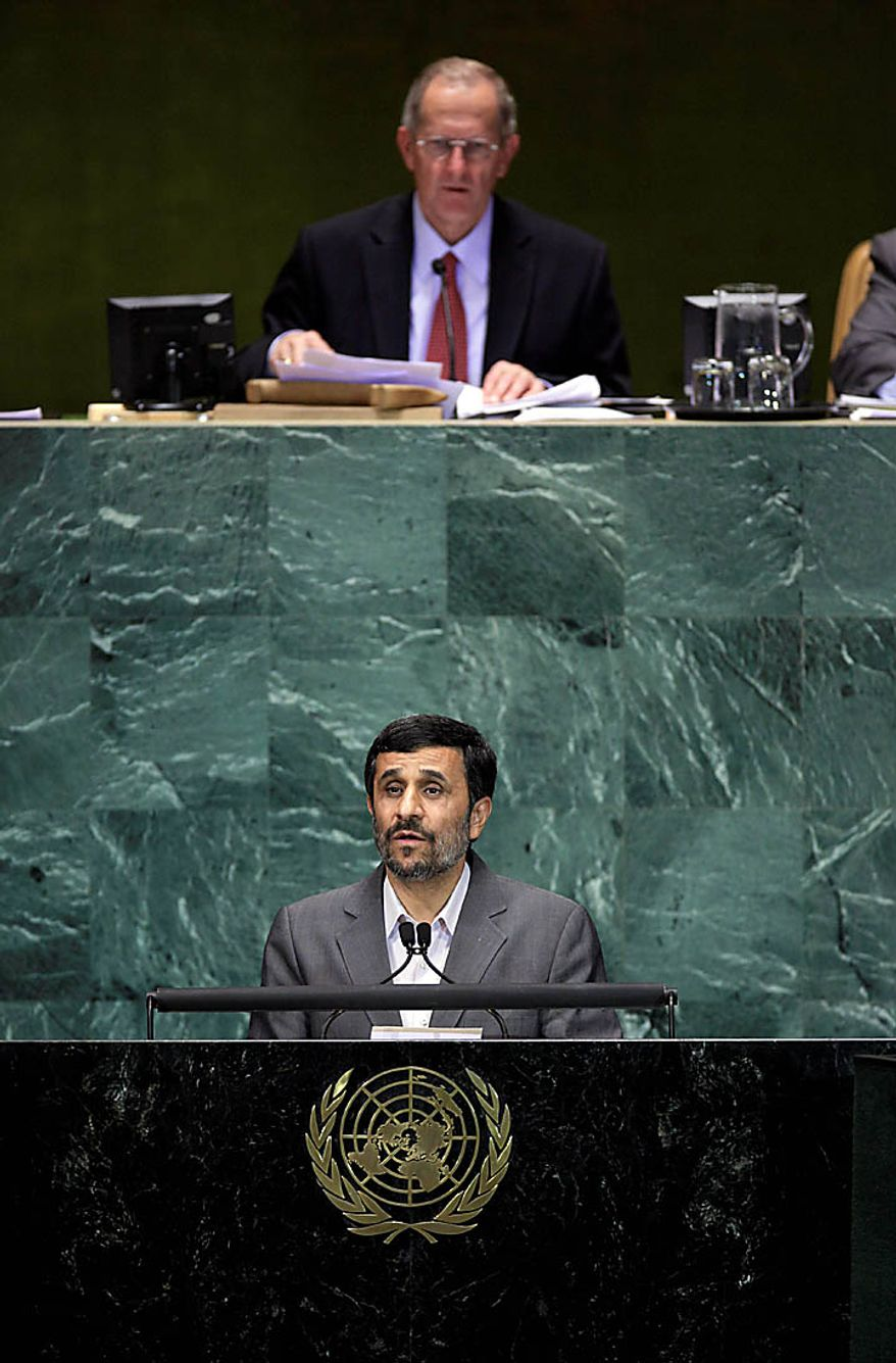 Mahmoud Ahmadinejad, President of Iran, addresses a summit on the Millennium Development Goals at United Nations headquarters on Tuesday, Sept. 21, 2010. At top is UN General Assembly President  Joseph Deiss. (AP Photo/Richard Drew)