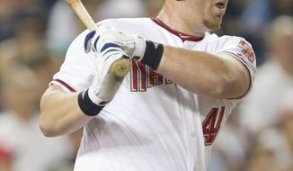 ASSOCIATED PRESS Washington Nationals' Adam Dunn hits a single during the first inning of a baseball game against the Houston Astros on Wednesday, Sept. 22, 2010, in Washington.