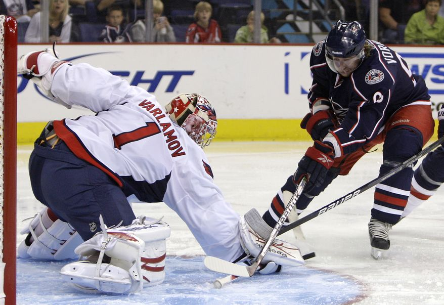 ASSOCIATED PRESS Washington Capitals' Semyon Varamov, left, of Russia, makes a save against Columbus Blue Jackets' Jakub Voracek, of the Czech Republic, during the second period of an NHL hockey game Wednesday, Sept. 22, 2010, in Columbus, Ohio.