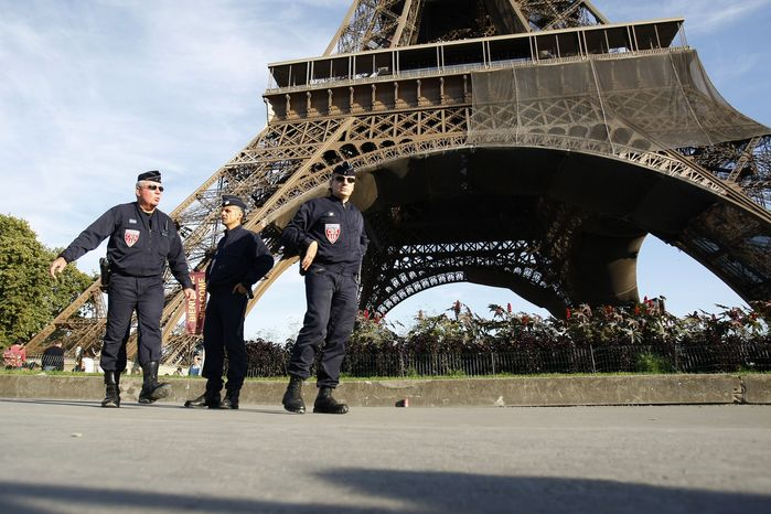 **FILE** Police patrol under the Eiffel Tower in Paris on Monday, Sept. 20, 2010, as part of the reinforcement of security. The director of France's national police said Wednesday that the threat of a terrorist attack on French soil is at its highest