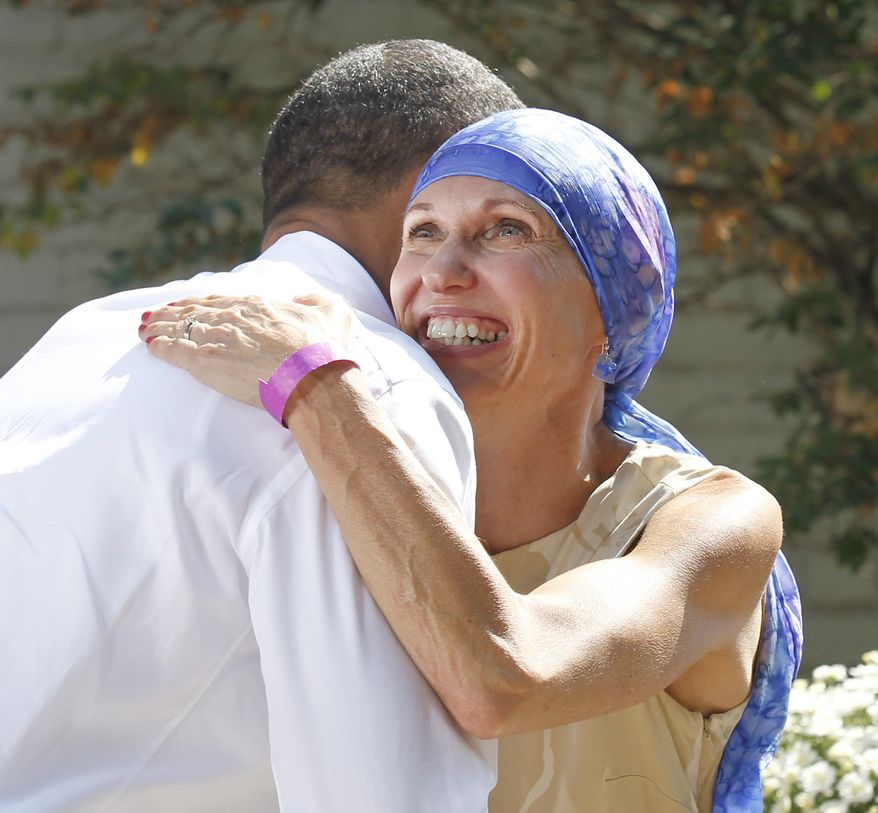 President Obama greets Gail O'Brien, from Keene, N.H., in the backyard of a private residence in Falls Church, Va., Wednesday, Sept. 22, 2010, to discuss the Patient's Bill of Rights and health care reform. Earlier this year, Ms. O'Brien was diagnosed with high grade non-Hodgkin's lymphoma and had no health insurance. (AP Photo/Pablo Martinez Monsivais)