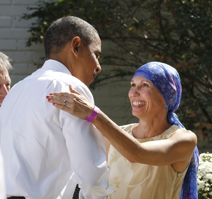 **FILE** President Obama greets Gail O'Brien, from Keene, N.H., in the back yard of a private residence in Falls Church, Va., on Sept. 22 to discuss the Patient's Bill of Rights and health care reform. Earlier this year, Ms. O'Brien was diagnosed with high grade non-Hodgkin's lymphoma and had no health insurance. (Associated Press)