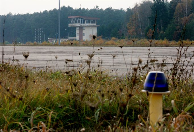 ** FILE * The runway and control tower of the airport in Szymany, Poland, is show in 2005. Prosecutors are investigating possible abuse of power by Polish public officials in connection with a closed CIA black site near the secluded airport, in the country's northeast, to which flight logs trace several landings of planes linked to the CIA. (AP Photo, File)