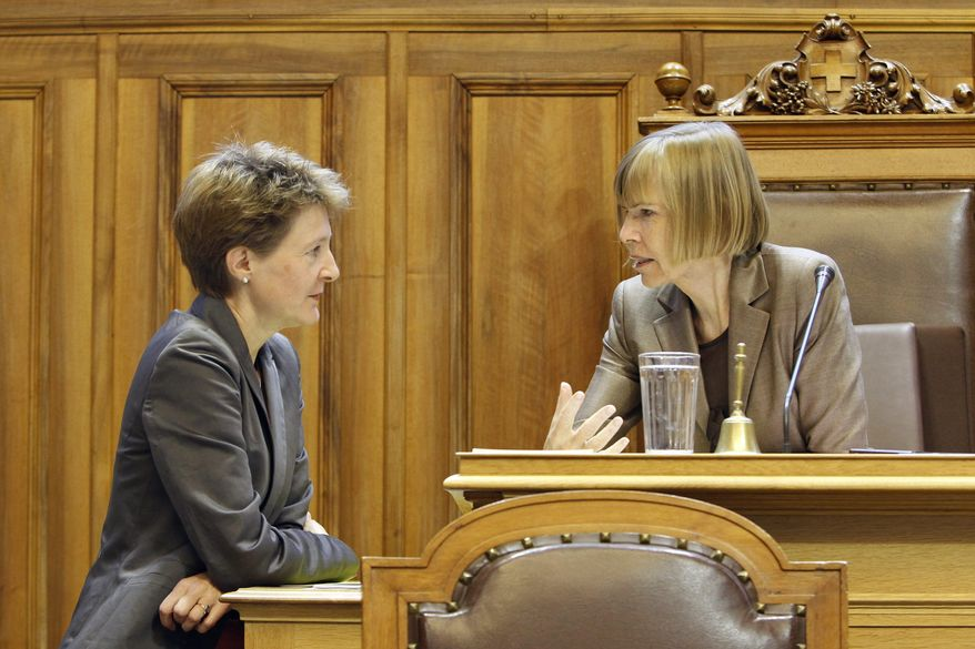 Swiss Social Democrat lawmaker Simonetta Sommaruga, left, talks to Erika Forster from the Free Democratic Party, during a session of the upper chamber of the Swiss parliament, on Tuesday, Sept. 21, 2010, in Bern, Switzerland. Swiss women claimed a majority of Cabinet seats Wednesday. (AP Photo/Keystone, Peter Klaunzer)