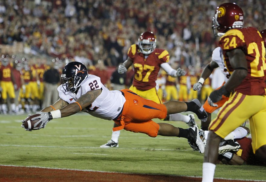ASSOCIATED PRESS FILE - In this Saturday Sept. 11, 2010, file photo, Virginia running back Keith Payne dives across the goal line for a touchdown as Southern California corner backs Shareece Wright (24) and Nickell Robey (37) look on during the second quarter of an NCAA college football game in Los Angeles.