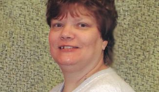 This 2007 file photo provided by newsPRos shows Teresa Lewis, 41, who is scheduled to die by injection Thursday, Sept. 23, 2010, for trading sex and money in the hired killings of her husband and stepson in October 2002. (AP Photo/newsPRos, File)