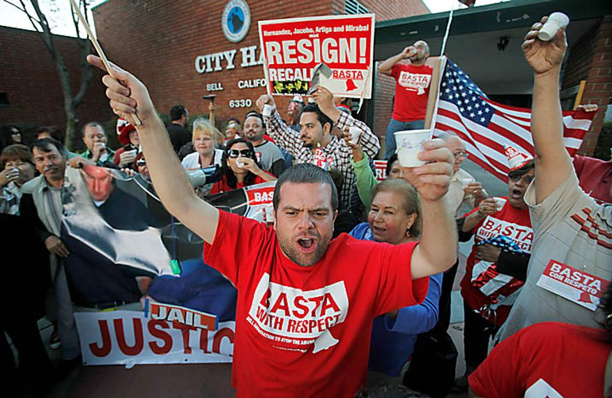 "Hoisting a celebratory toast of sparkling cider, Jesus Casas, a member of the Bell Association to Stop The Abuse, or BASTA, which also means ""enough"" in Spanish, joins other residents of the city of Bell, Calif., celebrating the arrest of current and former city officials on corruption charges, outside City Hall Tuesday, Sept. 21, 2010.  (AP Photo/Reed Saxon)"