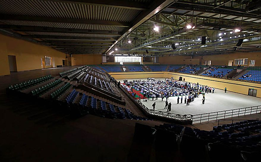 FILE- In this Sunday, April 25, 2010 file photo, people attend the inauguration of the newly-constructed wrestling stadium at the Indira Gandhi Sports Complex, one of the venues for the Commonwealth Games, in New Delhi, India, where part of a drop ceiling collapsed Wednesday Sept 22 2010, the day after a pedestrian footbridge failed injuring 27 workers . (AP Photo/Mustafa Quraishi, file)