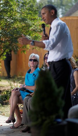 Health and Human Services Secretary Kathleen Sebelius looks on at left as President Barack Obama speaks in the backyard of a private residence in Falls Church, Va., Wednesday, Sept. 22, 2010, to discuss the Patient's Bill of Rights and health care reform.  (AP Photo/Pablo Martinez Monsivais)