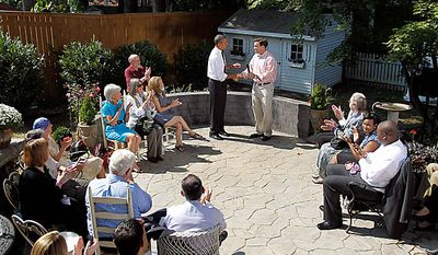Paul Brayshaw, right, introduces President Barack Obama, in his backyard in Falls Church, Va., Wednesday, Sept. 22, 2010, where the president discussed the Patient's Bill of Rights and health care reform. (AP Photo/Pablo Martinez Monsivais)