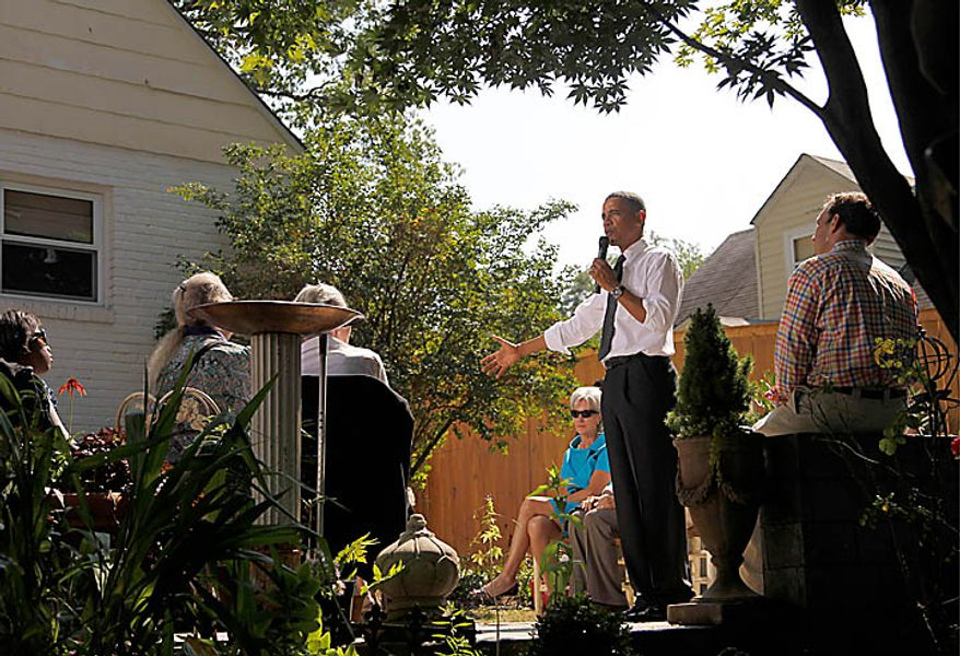 President Barack Obama, accompanied by Health and Human Services Secretary Kathleen Sebelius, center, talks in the backyard of a private residence to discuss the Patient's Bill of Rights and health care reform, Wednesday, Sept. 22, 2010, in Falls Church, VA. (AP Photo/Pablo Martinez Monsivais)