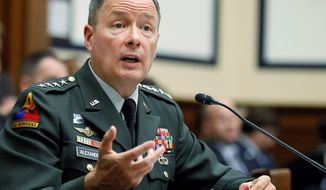 """How do we develop the team between Department of Homeland Security, FBI, Cyber Command and others to work as a team to defend the nation in cyberspace?"" asked Gen. Keith Alexander as he testifies on Capitol Hill on Thursday before the House Armed Services Committee hearing on cyberspace operations. (Associated Press)"