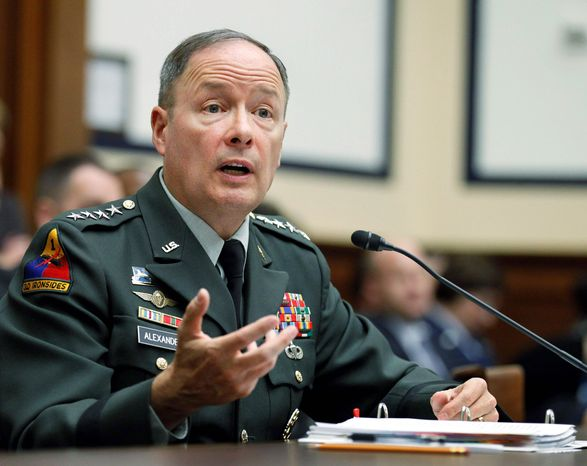 """""""How do we develop the team between Department of Homeland Security, FBI, Cyber Command and others to work as a team to defend the nation in cyberspace?"""" asked Gen. Keith Alexander as he testifies on Capitol Hill on Thursday before the House Armed Services Committee hearing on cyberspace operations. (Associated"""