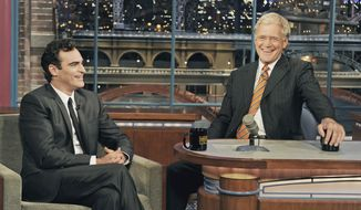 """In this photo released by CBS, actor Joaquin Phoenix, left, joins host David Letterman on the set of the """"Late Show with David Letterman,"""" Wednesday, Sept. 22, 2010, in New York. This is Phoenix's first television appearance and first visit to the CBS broadcast since February 2009. (AP Photo/CBS, Jeffrey R. Staab)"""