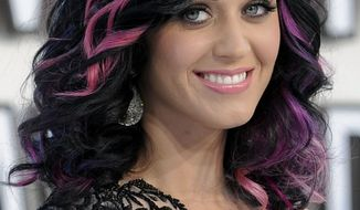 ** FILE ** In this Sept. 12, 2010, photo, Katy Perry arrives at the MTV Video Music Awards in Los Angeles. Sesame Street says it won't air a taped segment featuring Perry and Elmo. The pop star, who is known for her risque outfits, wore a gold bustier top as she sang. But some felt it was too revealing for the kid set. (AP Photo/Chris Pizzello)
